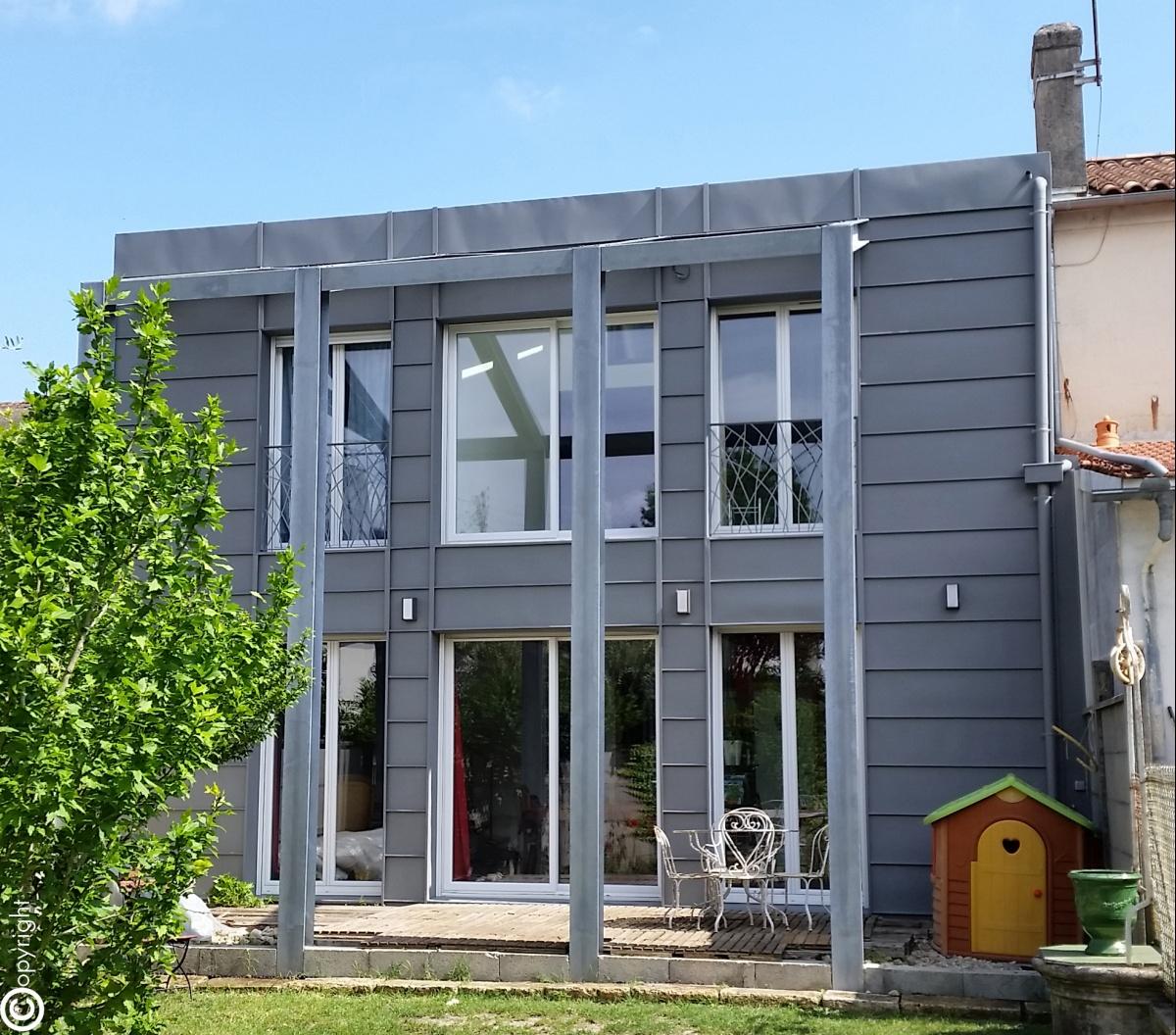 Réhabilitation et surélévation d'une maison individuelle