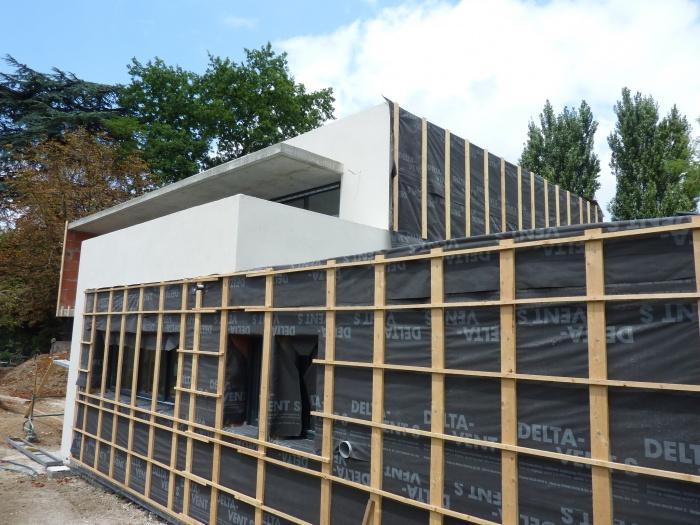 Maison contemporaine basse consommation : Préparation pose bardage bois