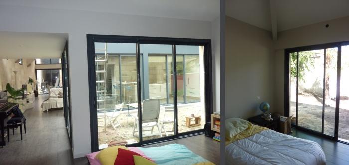 Hangar réhabilité en maison familiale : Espaces de vie 2
