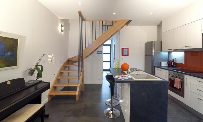 Réaménagement d'une maison d'habitation et construction d'un garage