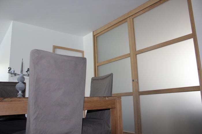 Extension et réaménagement d'une maison d'habitation : portes galandages cuisine