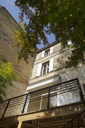 Réaménagement d'une maison d'habitation : façade sur jardin