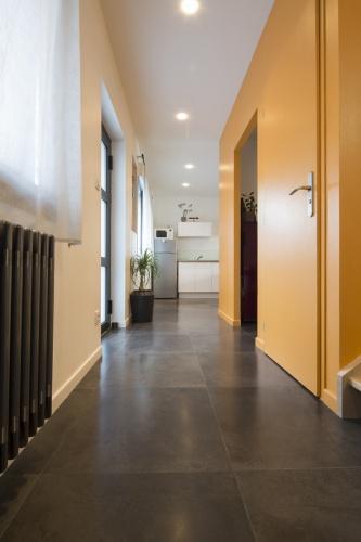 Surélévation et réaménagement  d'une maison d'habitation : entrée