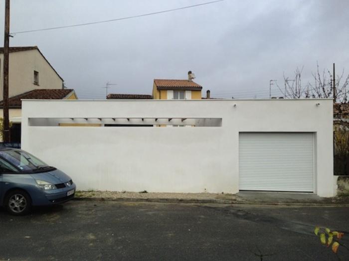 Extension d'une maison de ville : Façade de l'ensemble garage/terrasse