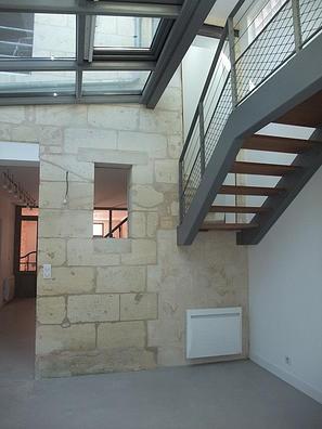 Réhabilitation d'une ancienne maréchalerie en une maison individuelle