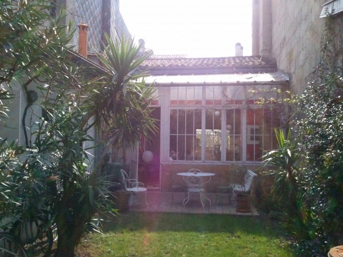 Maison BM : façade sur jardin avant travaux