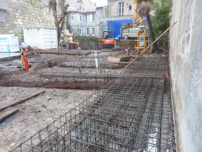 Construction d'un immeuble neuf à Bordeaux : Fondation sur mitoyen