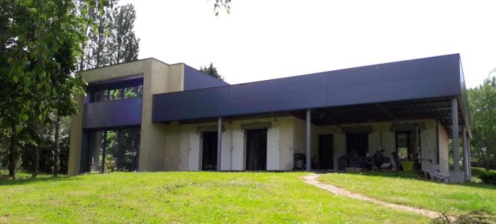 Extension contemporaine et rénovation d'une maison individuelle